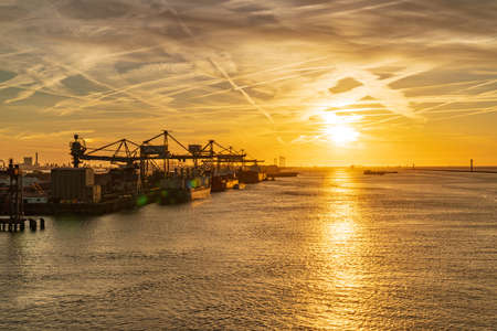 Rotterdam, South Holland, Netherlands - May 13, 2019: Sunset at the Calandkanaal, with a view towards the North Sea and the Europoort industry