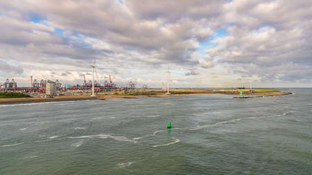 Rotterdam, South Holland, Netherlands - May 10, 2019: The North Sea coast with the industry on the shore of Europoort
