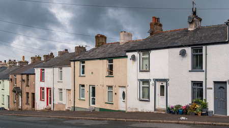 Dalton-in-Furness, Cumbria, England, UK - May 2, 2019: Dark clouds over the houses on Ulverston Rd