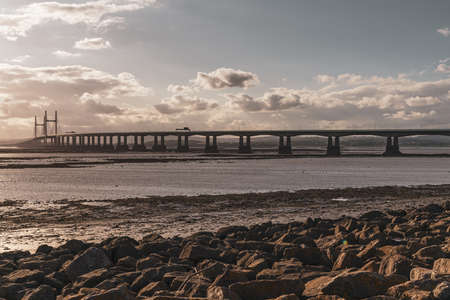 The Prince of Wales Bridge, leading the M4 over the River Severn, seen from Severn Beach, South Gloucestershire, England, UK Reklamní fotografie