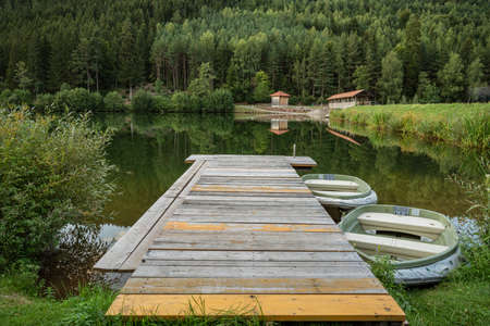 Bridge over the Nagoldtalsperre (Nagold reservoir) in the Black Forest with a jetty and boats in the front, near Freudenstadt, Baden-Wuerttemberg, Germany