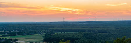 Evening light and some wind turbines in the Ruhr Area, seen from the Halde Haniel, Bottrop, North Rhine-Westfalia, Germany Imagens