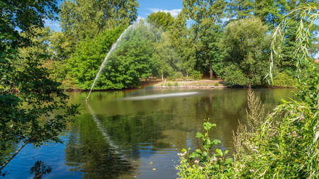 View over the pond of the park in Sterkrade, Oberhausen, North Rhine-Westfalia, Germany Imagens