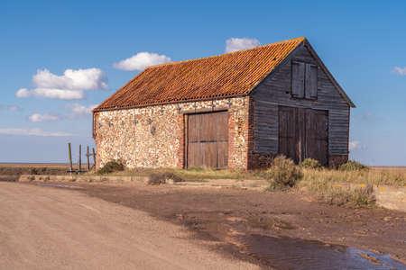 Thornham, Norfolk, England, UK - April 24, 2019: An old stone barn in Thornham Old Harbour Editorial