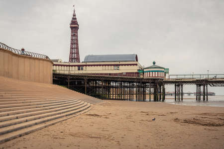 Blackpool, England, UK - April 28, 2019: View from the beach towards Blackpool Tower and the North Pier