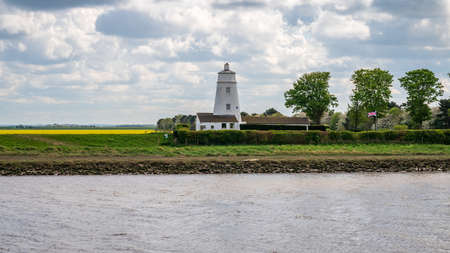 Guy's Head, Lincolnshire, England, UK - April 26, 2019: The River Nene and Sir Peter Scott East Lighthouse