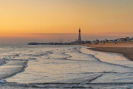 Blackpool, England, UK - April 29, 2019: Evening light over Blackpool, seen from the South Pier, looking north towards Central Pier and the Tower