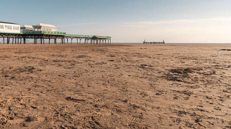 St Anne's, Lancashire, England, UK - April 29, 2019: View at the beach, the dunes, St. Anne's Pier and the remains of the landing jetty Editorial