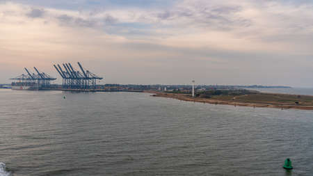 Felixstowe, Suffolk, England, UK - April 23, 2019: Approaching the harbour from the seaside, with port cranes in the background Editorial