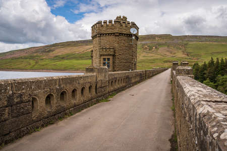 Near Middlesmoor, North Yorkshire, England, UK - May 19, 2019: The road over the dam of the Scar House Reservoir