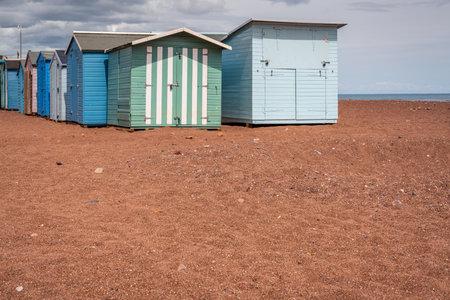 Teignmouth, Devon, England, UK - June 05, 2019: Beach Huts on Teignmouth Back Beach Editorial
