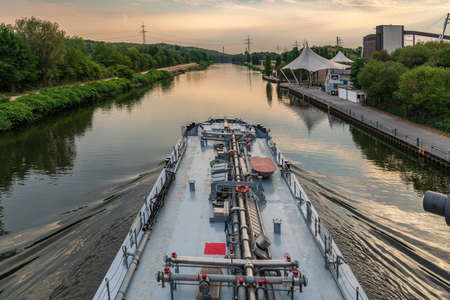 Gelsenkirchen, North Rhine-Westfalia, Germany - July 25, 2018: A ship on the Rhine-Herne Canal, seen from the Nordsternpark, with the Amphitheatre in the background Editorial