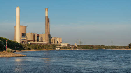 Voerde, North Rhine-Westfalia, Germany, August 08, 2018: The River Rhine and the decommissioned power station