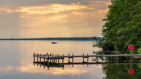 A jetty at the shore of the bathing island in Steinhude with view at the Steinhuder, Lower Saxony, Germany Archivio Fotografico