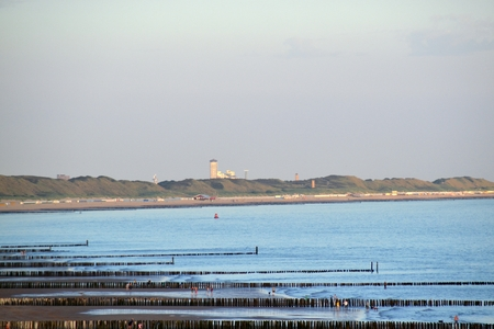 Blue North Sea with tower in the background Standard-Bild - 112550464