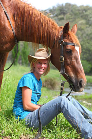 Jillaroo  cowgirl with her horse at the river