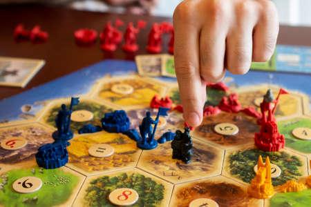 Balogunyom / Hungary - 01.04.2019: Board game party Settlers of Catan, popular board game. Players are scrambling the area to get more resources and victory points. Editorial