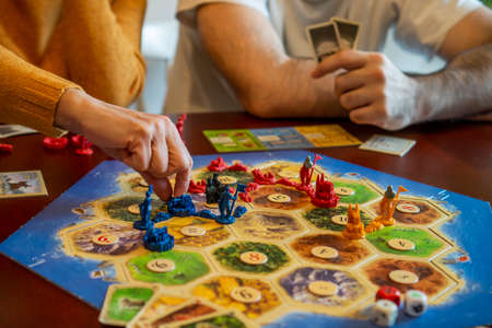 Balogunyom / Hungary - 01.04.2019: Board game party Settlers of Catan, popular board game. Players are scrambling the area to get more resources and victory points. Redakční