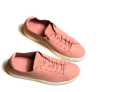 Pair of new pink sneakers on isolated white background with place for text 写真素材