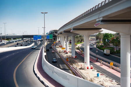 view of dubai infrastructure motorway with cars and constraction