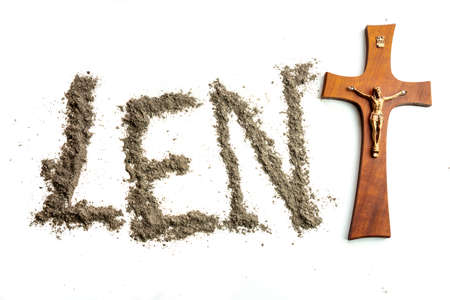 Lent word written iwith ash and christian cross as a T letter a religion concept Ash wednesday on isolated white background