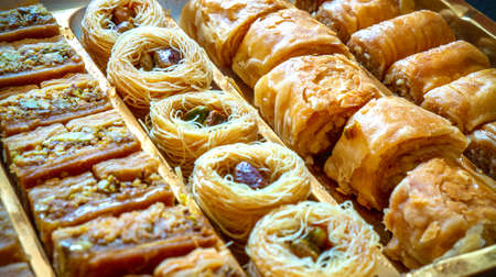 different type of arabian baklava in rows - borma nest ush-el-bul-bul asabi full screen close up