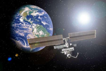 ISS prise avec la terre en arrière-plan dans l'espace avec la lumière des étoiles Éléments de cette image fournis par la NASA