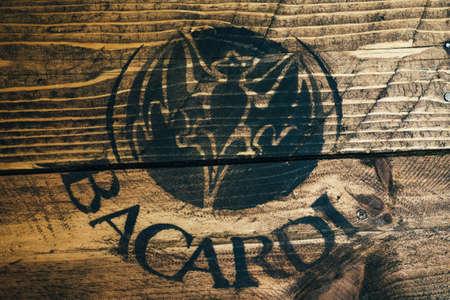 Black Bacardi white rum logo painted on rustic weathered wood