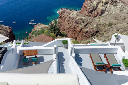 Romantic mediterraen vacation relaxing on a rooftop over the sea in Santorini Greece
