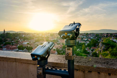 Coin Operated Binocular viewer next to the green hill garden in the middle of old town Veszprem, Hungary at sunset cliff Banque d'images