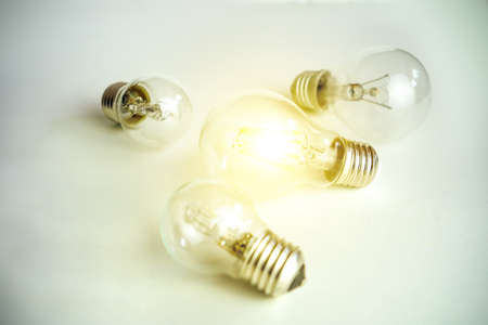 Light bulb lamps on white background one glowing concept of one special idea