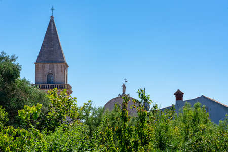 Beautiful historical old town Osor skyline over trees on Cres island church