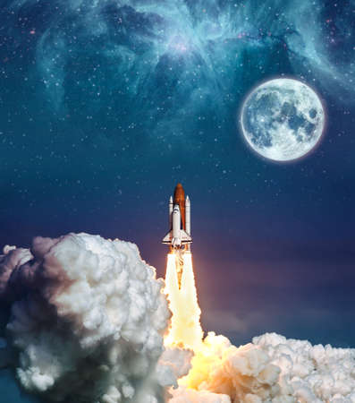 Cloudy launch of rocket Space Shuttle into colorful starry outer space and the full moon. The elements of this image furnished by NASA . Stock Photo