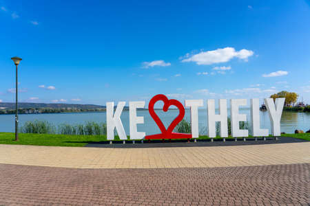 big Keszthely letters next to lake Balaton Hungary with heart shaped letters . 스톡 콘텐츠