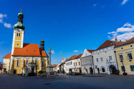 03.05.2020 -Koszeg, Hungary: Jurisics square in the historical beautiful Koszeg Hungary with statue and St. Emeric s Church .