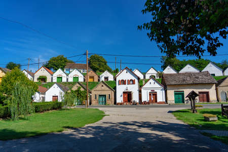 many colorful old traditional wine cellers in Villanykovesd in a hungarian wine region called Villany .