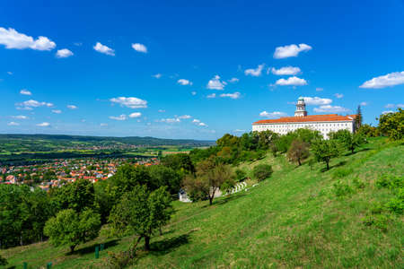 Pannonhalma abbey on the hill with view of the city and nature . Imagens