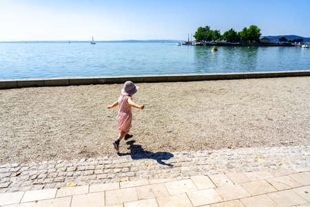 cute little girl is happy to be at the lake Balaton .