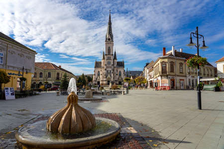 11.05.2020 - Kőszeg, Hungary : Old main town square with fountains and sacred heart church