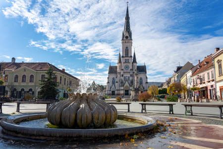 Old main town square with fountains and sacred heart church Kőszeg, Hungary