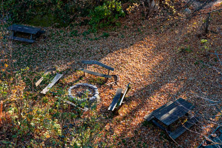 autumn forest with rustic outdoor furniture and fire pit resting place on a hiking trail Kőszeg Hungary