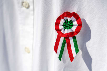 close up white shirt with tricolor rosette symbol of the hungarian national day 15th of march