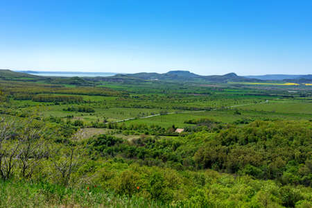 view of the kali basin from the hegyestu geological nature park with lake Balaton