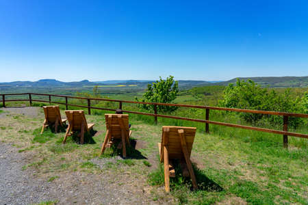view of the kali basin from the hegyestu geological nature park with lake Balaton with wooden sunbeds 免版税图像