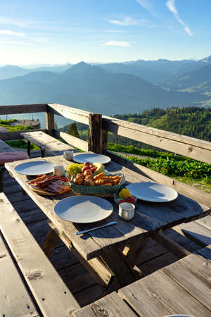 breakfast in a traditional hutte in tirol alms with fruits and wurst