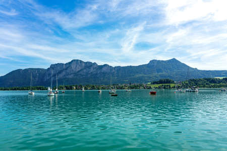 Mondsee with mountains and sailing boats on the water summertime