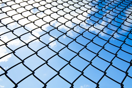 chain link fence: metallic net with sky background