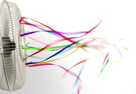Bright colorful silk ribbons on an electric fan