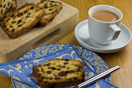 sultanas: A cup of tea and a slice of fruit loaf cake