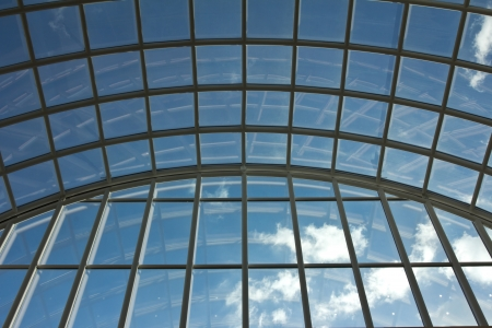 view of an atrium in a building: The windows to the clear blue sky